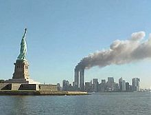220px-National_Park_Service_9-11_Statue_of_Liberty_and_WTC_fire